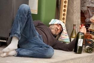 Hopeless drunk lying on the street